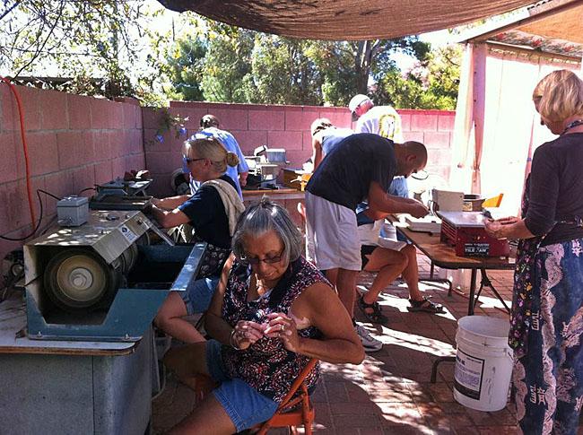 More club members enjoying rock cutting and polishing