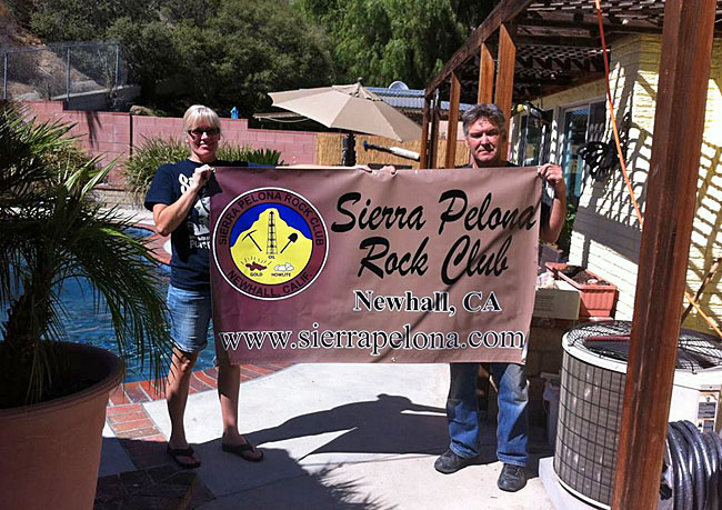 Trina and Bill hloding up the club's new banner ready for Lombardis.